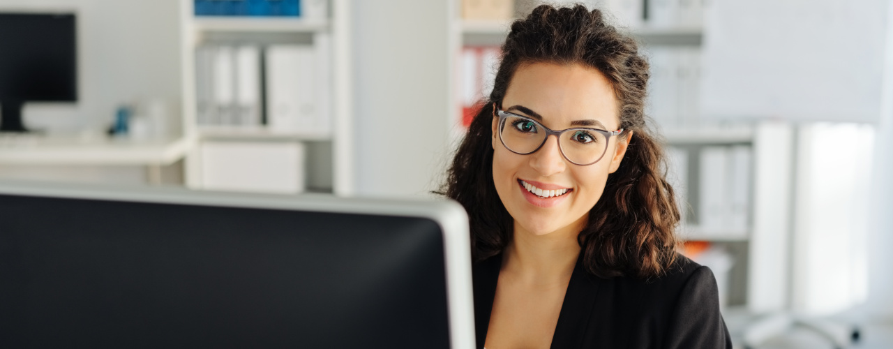 young-businesswoman-sitting-working-at-a-desktop